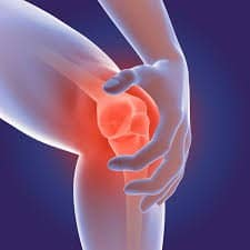 A knee showing the bone and red area being grabbed by a hand on a blue background