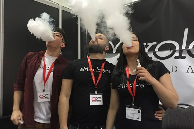 Why do people vape? Three people on a grey and black background