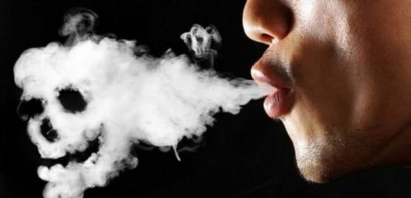 Person blowing smoke into the shape of a skull which implies the negative health effects of vaping.