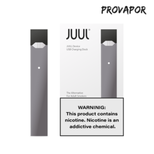 A slate Juul next to its box with the warning stating: Warning: This product contains nicotine. Nicotine is an addictive chemical.